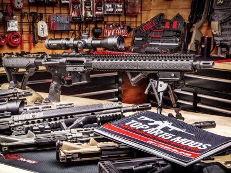 AR15 Gun sitting on desk next to TOP AR15 MODS Book
